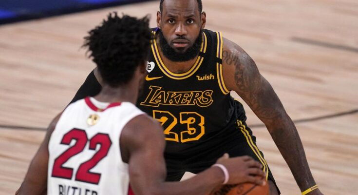 The Laker's LeBron James defends as Jimmy Butler, Miami Heat, has the ball. photo credit: forbes.com
